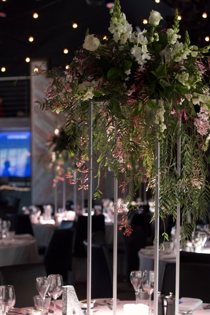 Wedding at The Cargo Hall. Foilage and floral centerpiece on floral stands