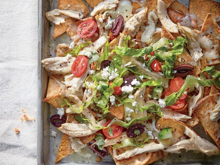 Dinner doesn't get much easier, or more fun, than sheet pan nachos. The pan does double duty: Toast the chips first, then pile high with toppings and return to the oven to melt the cheese and heat everything through. Here the Mexican classic takes a detour to Greece with pita chips, a shredded Greek salad, and crumbled feta. Rotisserie chicken breast makes this meal even easier, though this dish is a great use for any leftover cooked chicken. Bring the whole pan to the table and cut into…
