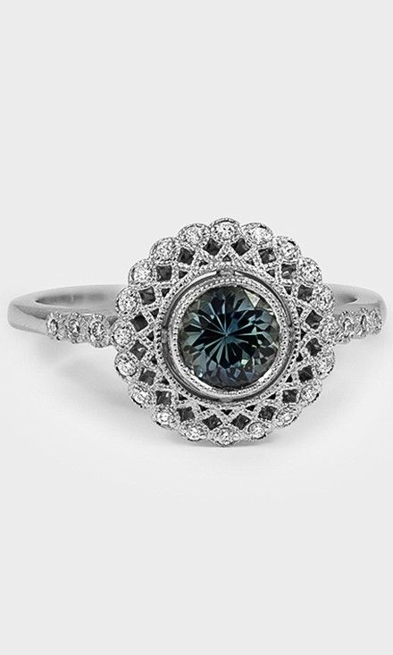This vintage-inspired ring is set with a stunning teal sapphire.