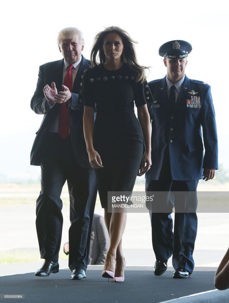 US President Donald Trump and US First Lady Melania Trump arrive to address US military personnel and families at Naval Air Station Sigonella after G7 summit of Heads of State and Government, on May 27, 2017 near Taormina in Sicily. /
