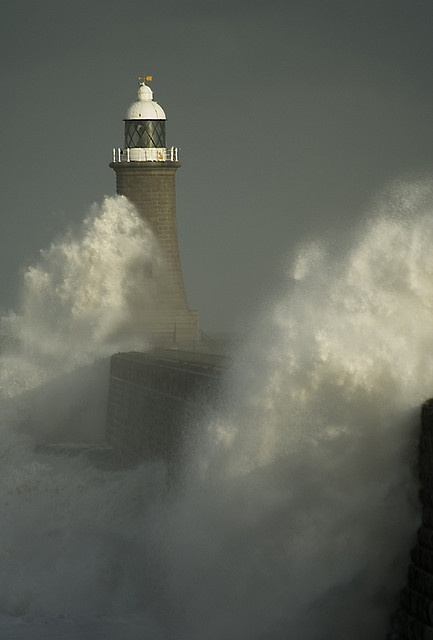Tynemouth lighthouse taking a pounding by rough seas