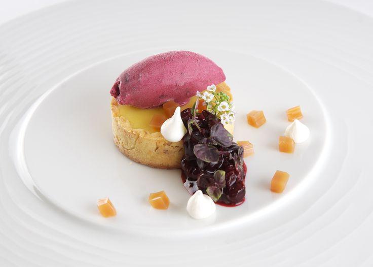 Signatures Restaurant at Le Cordon Bleu Ottawa, presents Yuzu tart, blackcurrant ice cream, meringue, blackcurrant compote and tea jelly.