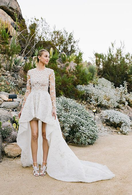 Brides.com: . Whitney Port marries Tim Rosenman in a high-low wedding dress by Ashi Studio, 2015.