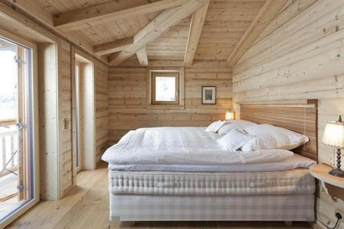 Beautiful Hästens bedroom. I bet the view is fab as well.