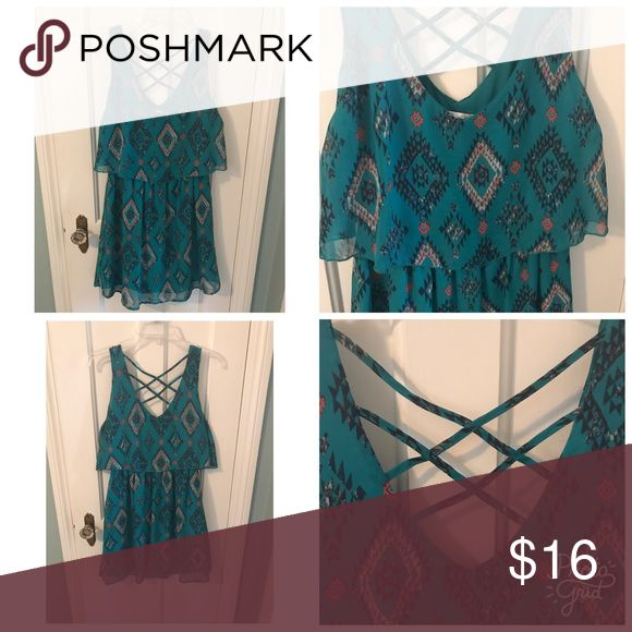 Summer Aqua Dress This summer dress is fun and flirty. The colors are bright and vibrant. The tank is scooped in the front and cross crossed in the back. The top part hangs over the waist which is a flattering look. From a smoke free house. Dresses Mini