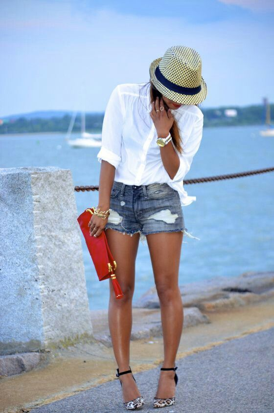 Shop this look on Lookastic:  http://lookastic.com/women/looks/dress-shirt-shorts-pumps-hat-watch-bracelet/10816  — Yellow Straw Hat  — White Watch  — White Dress Shirt  — Gold Bracelet  — Navy Ripped Denim Shorts  — White and Black Leopard Suede Pumps