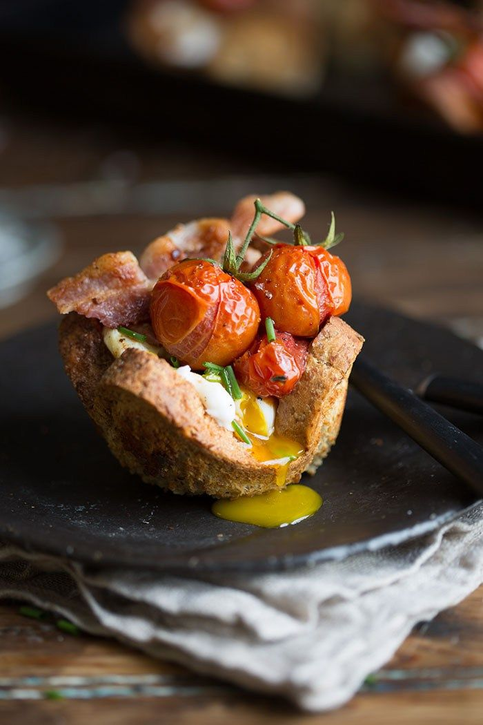 Poached egg and bacon in bread basketswith roasted tomatoes