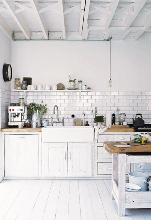 rustic kitchen with white floors and white subway tiles designed by Paul Massey / sfgirlbybay