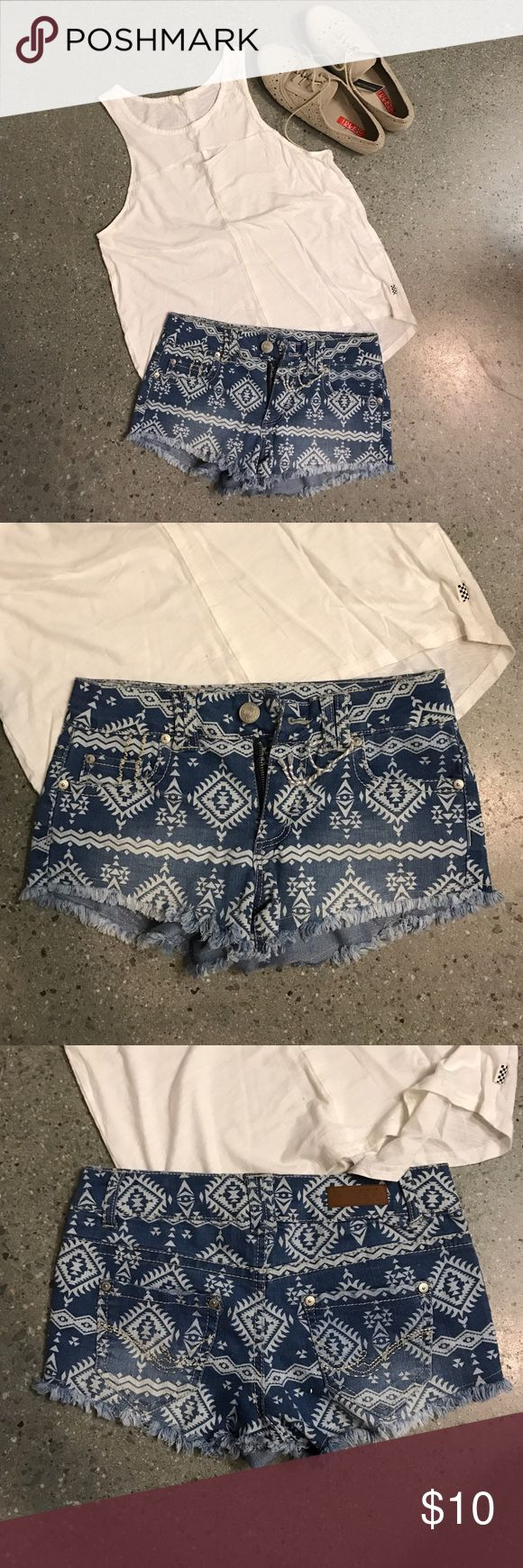 Tribal shorts Shorts with a printed Aztec pattern on them -- NWOT. These shorts are pretty short, but super cute for festivals! harmony and havoc Shorts Jean Shorts