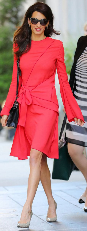 Who made  Amal Clooney's red dress and black handbag?