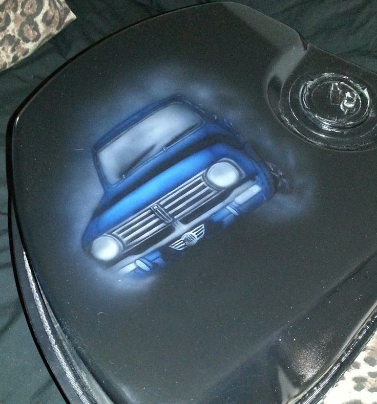 my daughter air brushed a mini mural on my fuel tank
