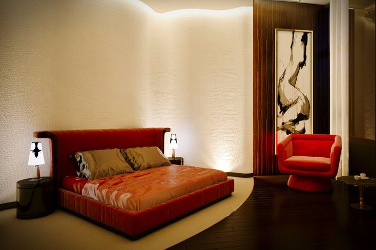 Luxurious bedroom design with a luscious red bed and armchair combo, on a bedroom that features great attention to detail.