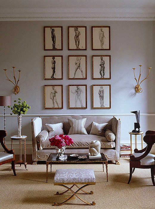If you have an expansive wall to fill, consider a grouping of artworks with one theme, such as portraits, landscapes, or nude drawings!