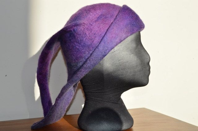 This most unusual hat is double layered in hand dyed and wet felted merino wool, it is deep teal, purple, green and deep rose by FeltTheFluff on Etsy