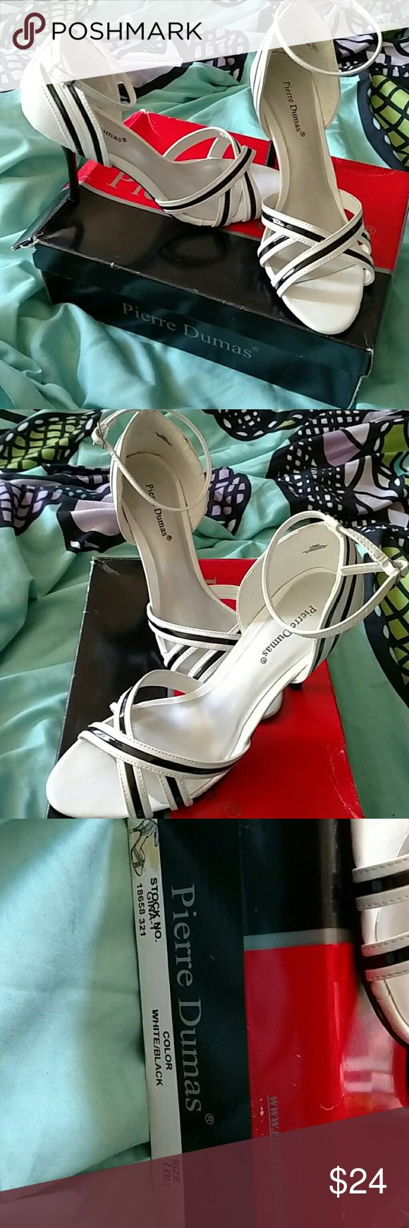 Pierre Dumas strappy heels These are Pierre Dumas Gina Size 10m. I wore these one time for a wedding..I still have the box if you need. They are black and white. They have been in box in the back of my closet Pierre Dumas Shoes Heels