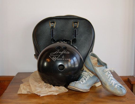 This is a fabulous set of mid century bowling equipment, including a 12 lb. 6 oz. black Amflite Magic Line ball, powder blue Hyde leather