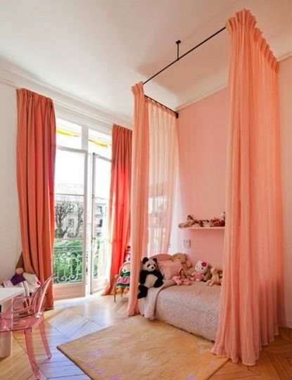 "Sheer curtains hung around a bed like this would be a great way to separate the ""bedroom"" in a studio apt."