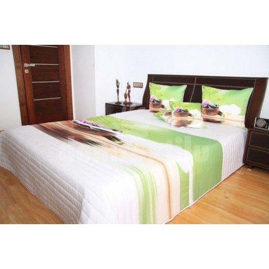 Zeleno biele prehozy na posteľ s orchideami a kameňmi