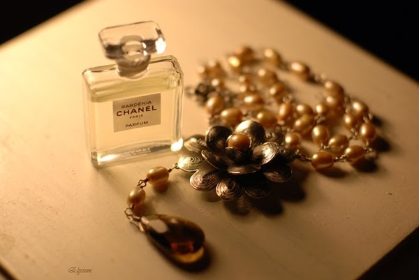 Chanel Gardenia with pearl necklace