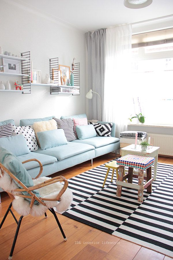 The small rugs together as one and those shelves! I love the polka dot pillows, too.