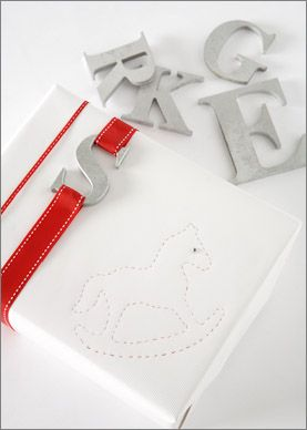 White wrapping with metal tags