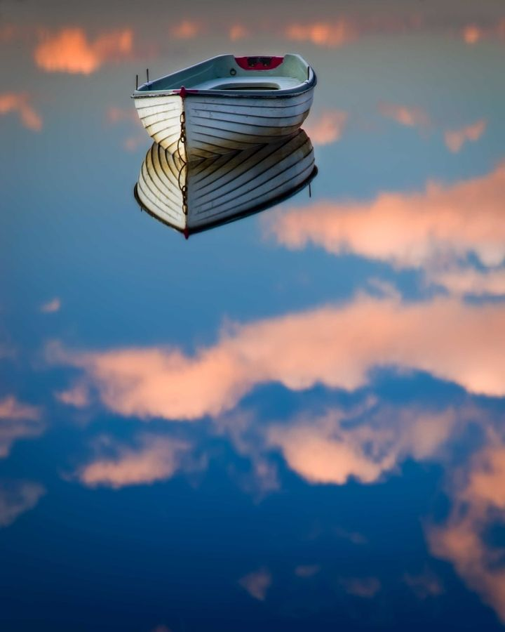 """""""Sometimes, in Scotland . . . """" by David Mould, via 500px. Blue skies and fluffy clouds reflected in Loch Rusky, with boat ready for the trout season."""