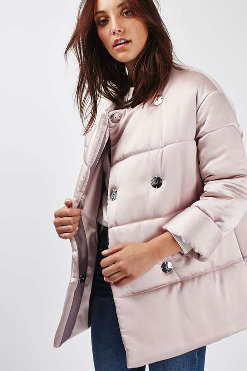 Look cute while keeping warm in this Premium puffer jacket in baby pink satin, featuring popper fastening to the front. Wear with a cosy jumper ripped jeans for a cool and casual look. #Topshop