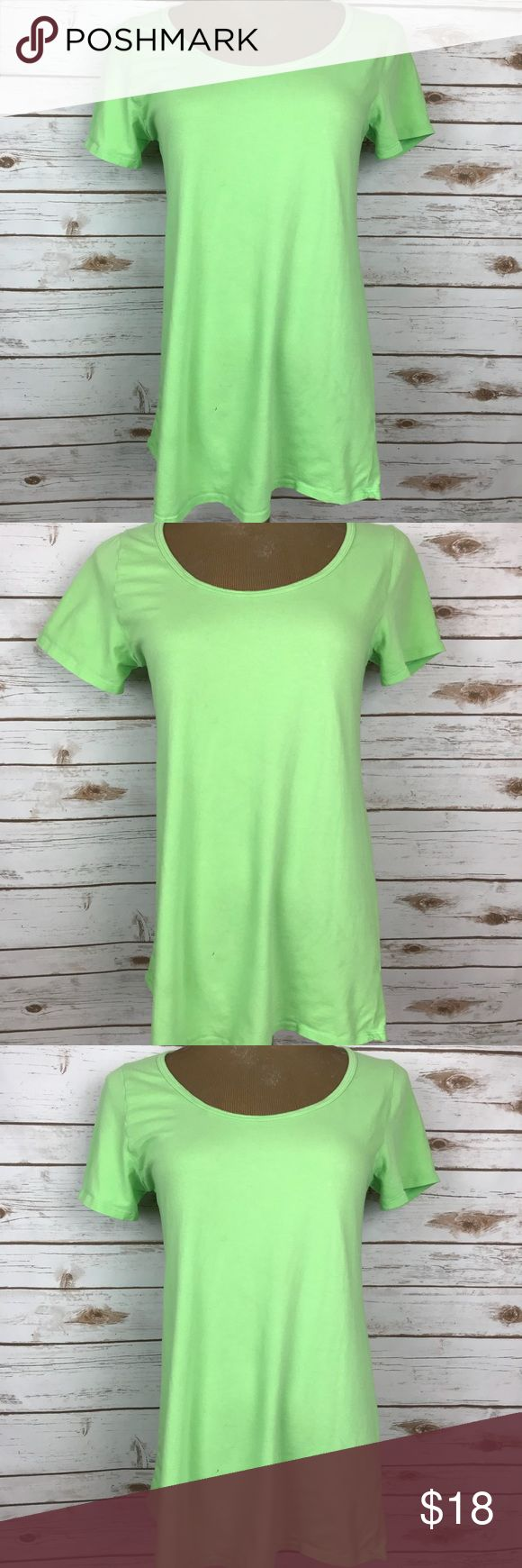 """LulaRoe Classic Tee Solid Lime Green Shirt Blouse Size Small  Bust 17.5"""" Length Front 27.5"""" Length Back 29"""" Lime Green  Short Sleeves Hi Low Style  95% Cotton, 5% Spandex  Machine Wash Imported  In condition good  On lower front small pin hole and a couple grease spots; see photos LuLaRoe Tops Blouses"""