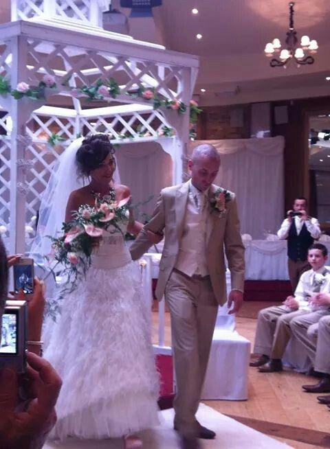 wedding gazebo- feathers, cream suit