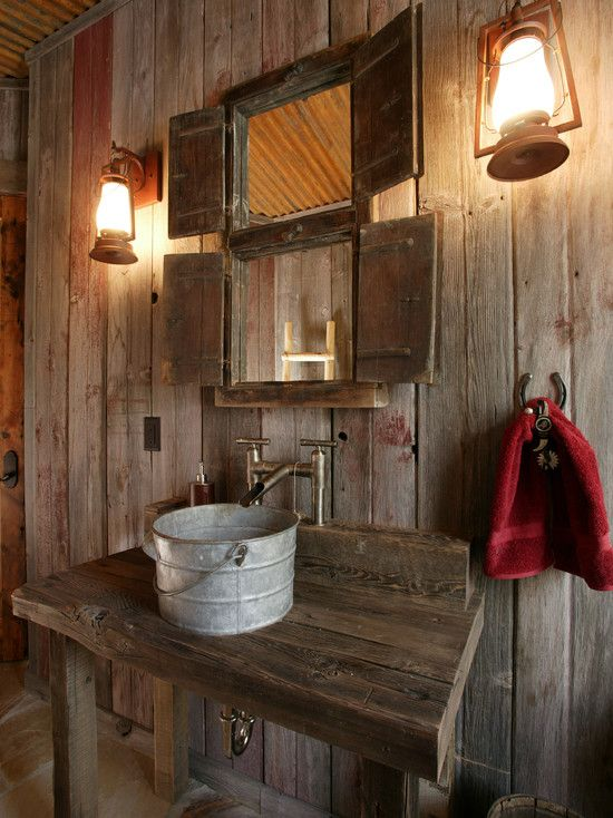 This was a fun powder room design for a western mine style home with the corten ceiling, old bucket for a sink and Old California Lanterns for the lighting.