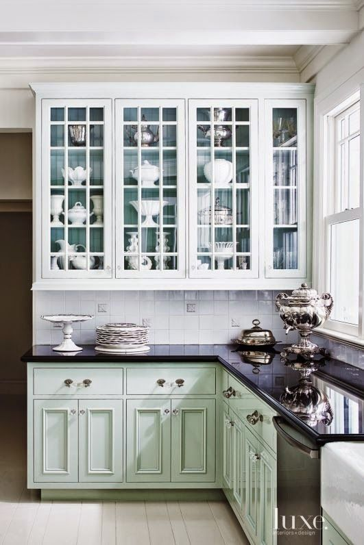 LOVE the color in back of the glass front cabinets