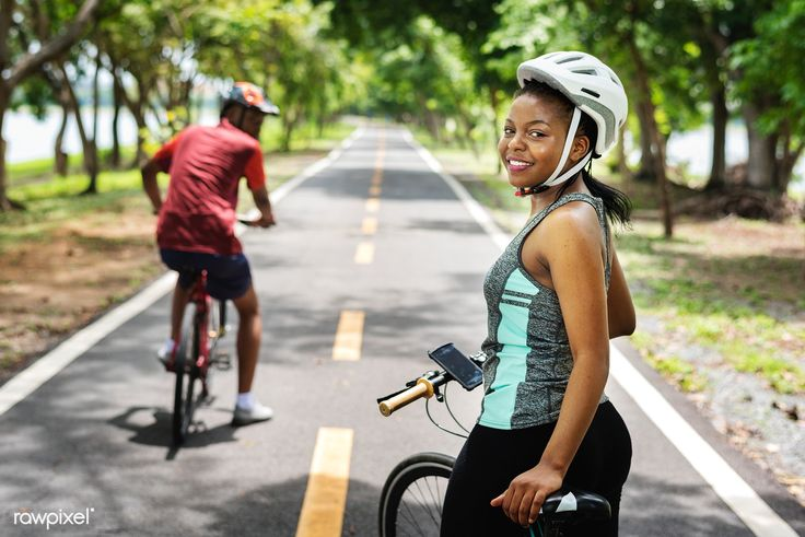 Download Premium Image Of Cyclist Couple Riding Bikes In A Park 441925 Bike Ride Ride Bicycle Cyclist