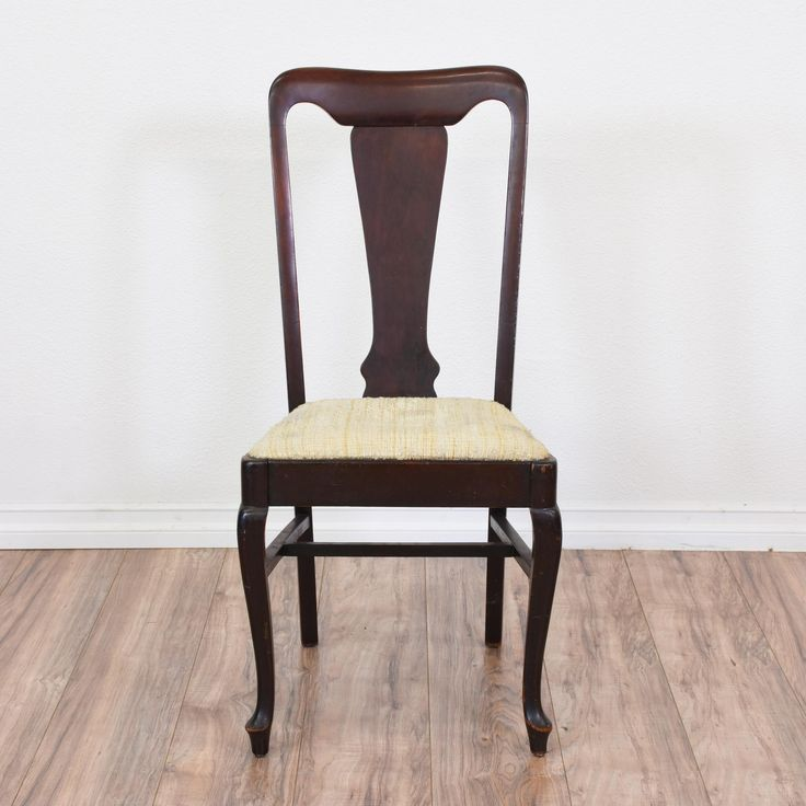 This contemporary Queen Anne chair is featured in a solid wood with a glossy dark cherry finish. This dining chair is in great condition with a modern carved back, simple cabriole legs and off white and yellow woven seat cushion. Perfect for a dining table or desk! #victorian #chairs #chair #sandiegovintage #vintagefurniture