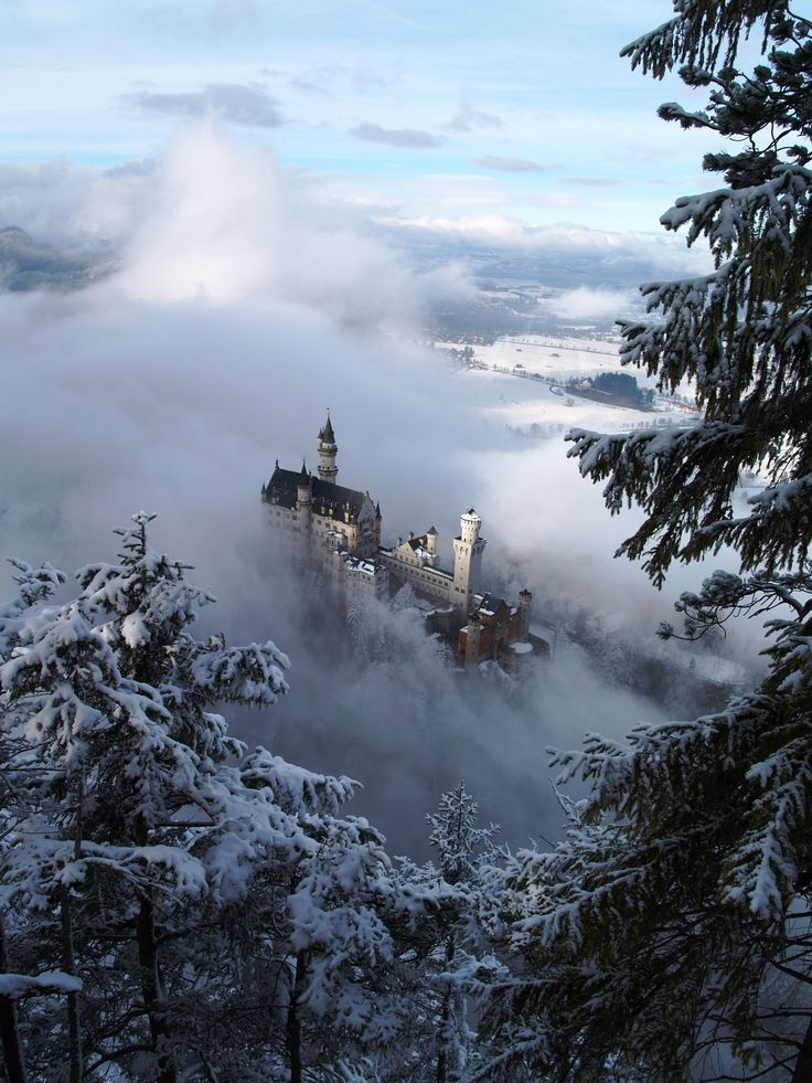 The castle rising from out of the Winter mist is  Schloss Neuschwanstein - Bavaria, Germany **Schreiner88