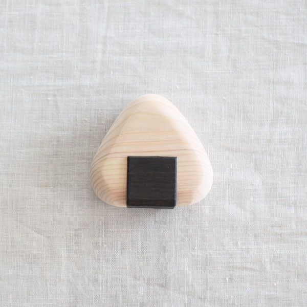 Onigiri Hinoki Wood Teether | UGUiSU Online Store | Possibly one of the cutest baby teethers you can find...? Onigiri teether made with Hinoki wood by craftsman in Odawara. Hinoki wood has bactericidal and antibacterial effects and is safe for babies to bite or lick. Wood teether helps get those new teeth through the gums. Comes in a triangle shape lidded paper box and is perfect for a gift for new born babies.