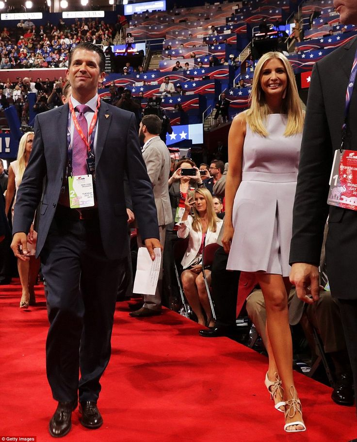 Ivanka (right) walks into the Quicken Loans Arena in Cleveland alongside her older brother Donald Jr