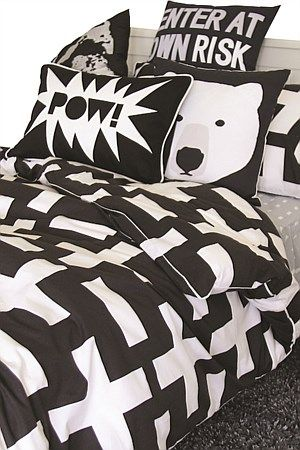 This strong masculine but simple design is super cool. Crosses & blocks of white on a charcoal background, create a composed & elegant duvet cover for any age group; especially appealing to teenagers. Add a pop of colour – lime, orange or yellow.