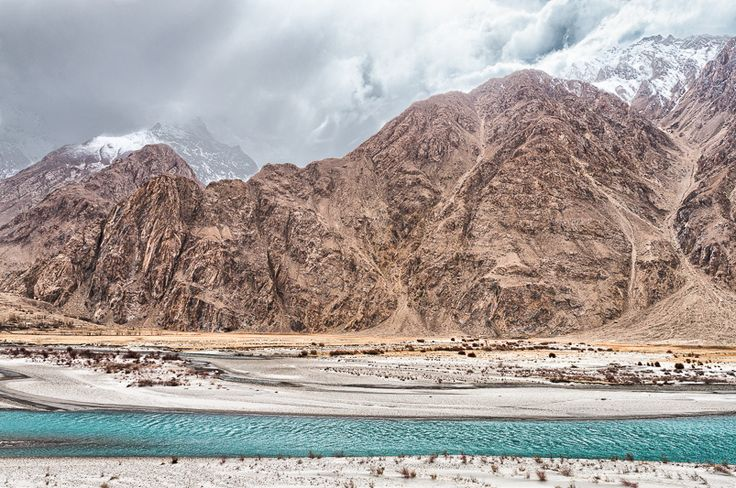 Pamir mountains in Afghanistan. The Panj river runs along much of the border between Afghanistan and Tajikistan.
