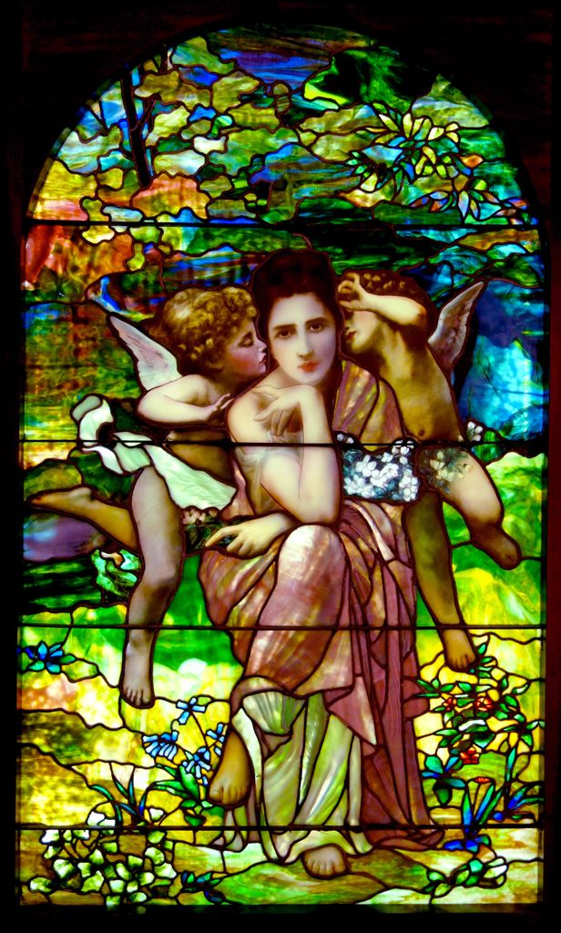 'Chansons de Printemps', stained glass window based on the painting by William-Adolphe Bouguereau, and attributed to Louis Comfort Tiffany, Tiffany Glass & Decorating Co. Exhibited at the New Britain Museum of American Art, Connecticut, USA. Original Photo: Daderot (CC0-PD 1.0)
