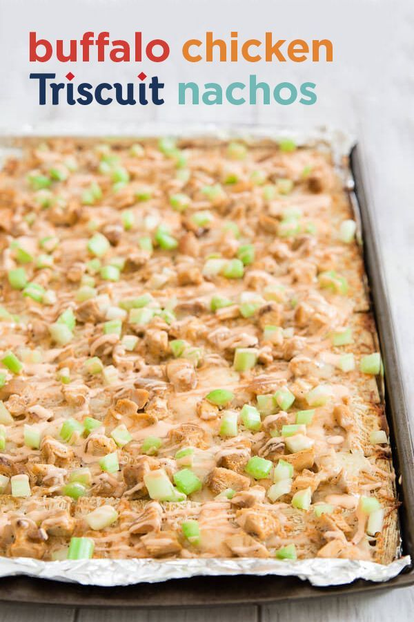Nachos with a guaranteed crunch. Buffalo sauce covered chicken with shredded cheese and chopped celery all on a Triscuit. Just bake for ten minutes and serve. Triscuit. Made for More.