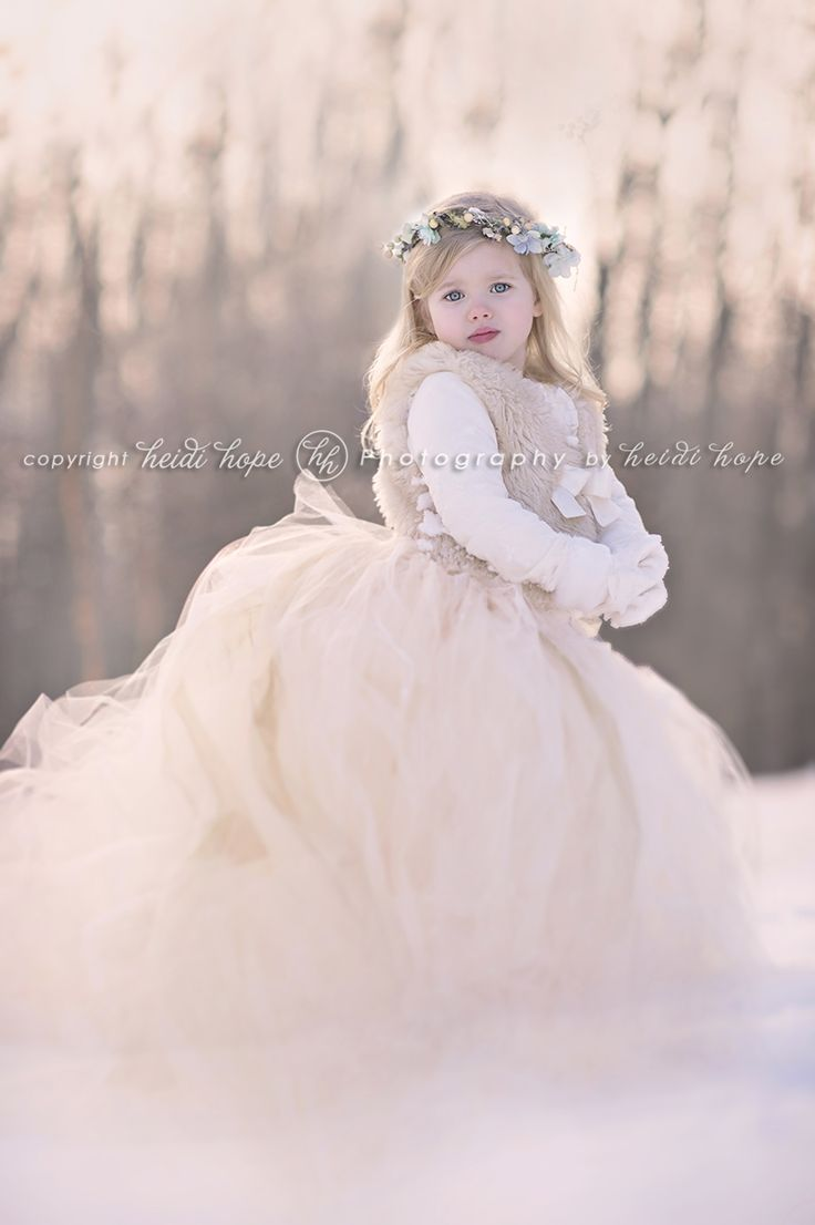My favorite from the day.  Snow angel.  Heidi Hope Photography.  http://www.heidihope.com