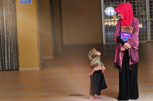 Muslim Woman Teaches Her Little Sister Quran