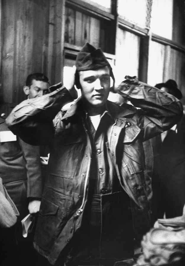 And being dressed in his army uniform. | 21 Unbelieveable Candid Photographs Of Elvis Presley In The Army