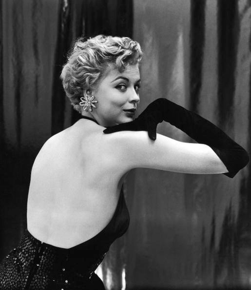 Model Barbara Rolfe in bare-back sequined sheath from Traina-Norell, photo by Sharland, used for the cover of LIFE, October 12, 1953