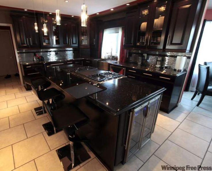 Kitchen: 'Black Galaxy' granite countertop with espresso ... on Maple Cabinets With Black Granite Countertops  id=24045