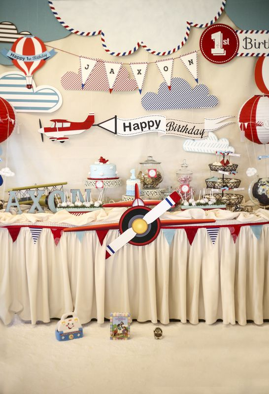 Airplane theme 1st birthday party head table and back drop design. All custom hand made for the specific theme.