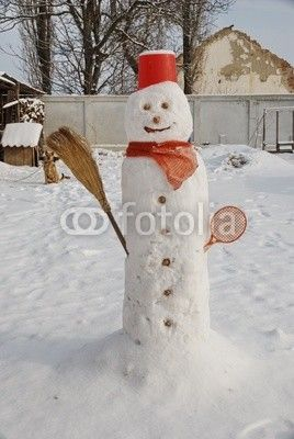 Snow man in my garden, rustic composition during the winter holidays