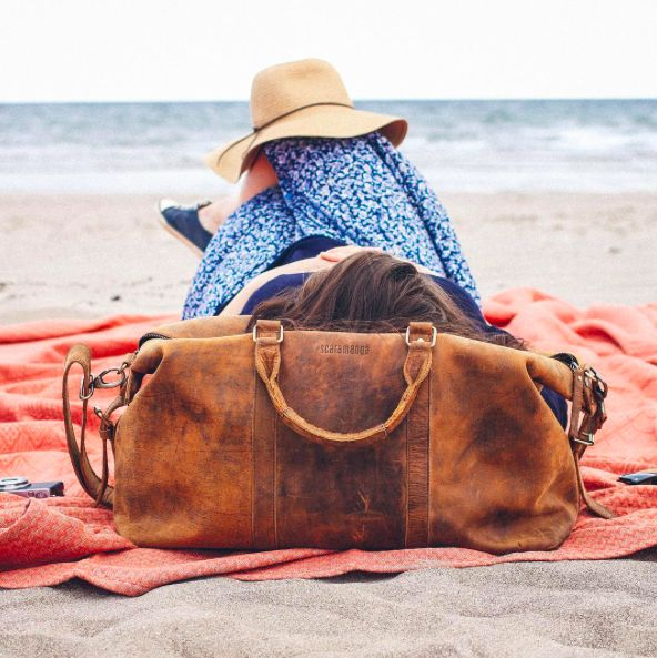 Relax at the beach with our leather duffle bag. #leather #bag #musthave
