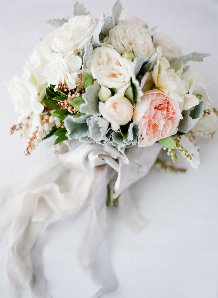 Pastel ranunculus, rose, lambs ear + ribbon bouquet: http://www.stylemepretty.com/2015/11/04/the-best-ever-ribbon-bouquets-you-need-to-see-right-now/