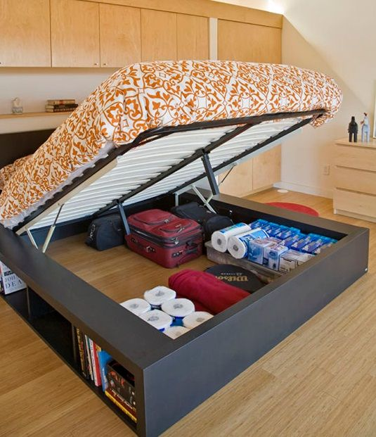 I may have pinned this already, but I love this idea. It would work great to store luggage and extra bedding but still have the spots around for us to be able to have the bin storage for clothing.